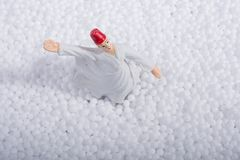 Sufi Whirling Dervish on white polystyrene  balls. Sufi Whirling Dervish on little  white polystyrene foam balls Stock Photography