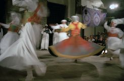 Sufi whirling dervishes, Cairo, Egypt. A Sufi whirling dervish is dancing in Al Ghouri Medrese, old town Cairo Stock Photography