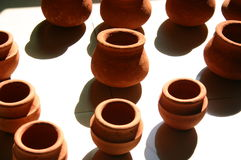 Sugadi drying in the sun. Sugadi, a clay pot traditionally made in Maharashtra, a western state in India, is used in many festivals for filling food. Before use royalty free stock photos