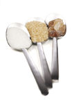 Sugar. Three diferrent kinds of sugar on spoons Royalty Free Stock Photos