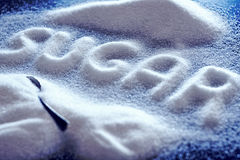 Sugar. Letters piled up with white sugar stock images