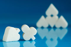 Sugar. Lump of sugar shaped heart with blue background Royalty Free Stock Photos