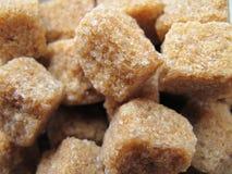 Sugar. Detail brown cane sugar cube Royalty Free Stock Photos