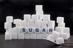 Sugar. Cubes as symbol for diabetes stock photography