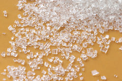 Sugar. Strewed sugar close-up on yellow background Royalty Free Stock Photos