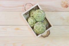 Sugar apple or Annona squamosa. Fresh Sugar apple or Annona squamosa in a wooden box Royalty Free Stock Photos