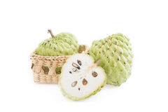 Sugar apple on the basket isolate on white background.  royalty free stock photos