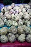 Sugar-apple fruit Annona squamosa on table for sell in market. Sugar-apple fruit Annona squamosa on table for sell in market of the tropical fruit that also Stock Photos