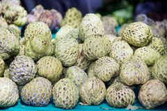 Sugar-apple fruit Annona squamosa on table for sell in market. Sugar-apple fruit Annona squamosa on table for sell in market of the tropical fruit that also Stock Photo