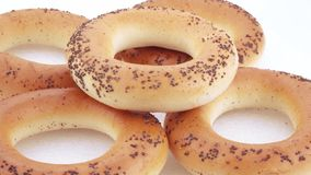 Sugar bagels with poppy seeds. A stack of bakery products. Wheat flour from the highest grade Sugar bread with poppy Kiev stock video