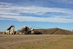 Sugar Beet Piler and Pile With Trucks Royalty Free Stock Photography