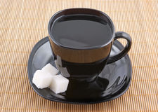 Sugar and black cup of coffee Stock Images