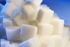 Sugar on blue. White sugar in cool and warm light Stock Images