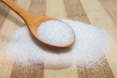 Sugar on the board and spoon Royalty Free Stock Photo