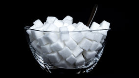 Sugar Bowl. Glass bowl full of sugar cubes - concept of consuming too much sugar Stock Photography