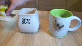 Sugar bowl on the table with the lid open. Preparing for tea stock video footage