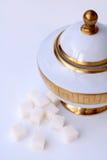 Sugar bowl and white sugar Royalty Free Stock Image