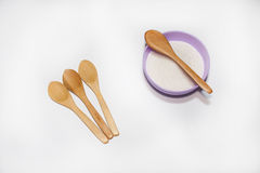 Sugar in the bowl and wooden spoons Stock Photos