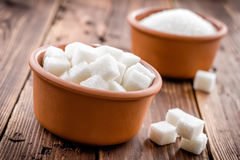 Sugar. In a bowl on a wooden table Royalty Free Stock Image