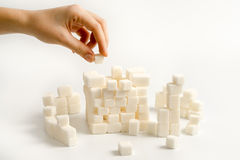 Sugar. Building a citadel from white sugar cubes Royalty Free Stock Photo