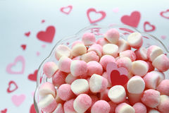 Sugar candies with a couple of Valentine's hearts on a romantic background Royalty Free Stock Photography