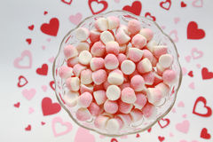 Sugar candies in a glass bowl on a romantic background Stock Images