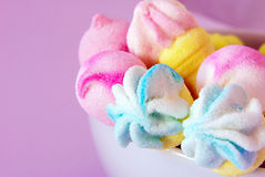 Sugar candy. In a withe cup on pink background Royalty Free Stock Image