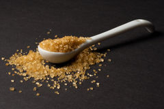 Sugar cane. A spoon of raw sugar Royalty Free Stock Images