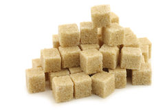 Sugar cane cubes. On a white background Stock Photos