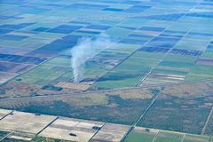 Sugar cane field on fire. royalty free stock photos