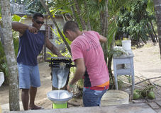 Sugar cane juice preparation by two cuban guys Royalty Free Stock Photo