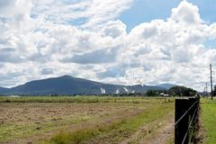 A Sugar Cane Mill In Surrounding Farmland. An Australian sugar mill refinery in production as it processes sugar cane from surrounding farmland in north stock images
