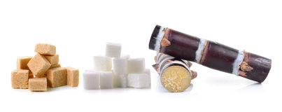 Sugar cane and sugar cube. On white background Royalty Free Stock Photos