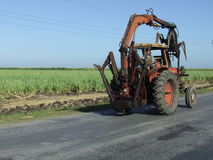 Sugar cane tractor. In a cuban country road Stock Photos