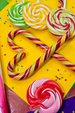 Sugar canes in a heart-shape and other sweets Stock Photography