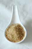Sugar in ceramic spoon. selective focus Royalty Free Stock Photo