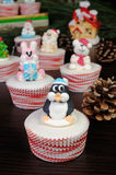 Sugar Christmas penguin figurine on a muffin Royalty Free Stock Images