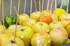 With sugar-coated apples. On a stick Royalty Free Stock Photo