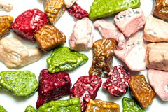 Sugar coated chocolate candy which has The shape imitate stone. Colorful of sugar coated chocolate candy which has The shape imitate stone royalty free stock images