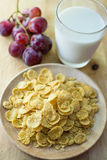 Sugar-coated corn flakes with milk. And grape background Stock Photography