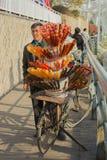 Sugar coated fruit (Tanghulu) seller at Tianjin the bun garden. Royalty Free Stock Photo