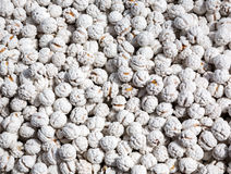 Sugar-coated nuts Stock Images
