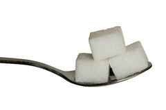 Sugar cobes on a teaspoon. Closup of sugar cubes on a teaspoon. good sharpness for a closeup Stock Photography
