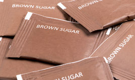Sugar. Collection of brown sugar packs. Top view Stock Photography