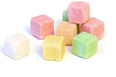 Sugar colored cubes. Pieces of colored sugar on a white background Royalty Free Stock Photos