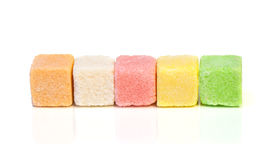 Sugar colored cubes. Pieces of colored sugar on a white background Royalty Free Stock Photo