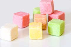 Sugar colored cubes. Pieces of colored sugar on a white background Royalty Free Stock Image