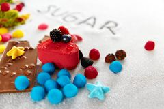 Sugar And Colorful Sweets On tabell Royaltyfria Bilder
