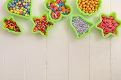 Multicolored sweets in baking molds. Place for text. royalty free stock photos