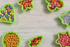 Multicolored sweets in baking molds. Place for text. stock images